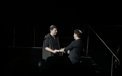 The two fans on stage during the concert