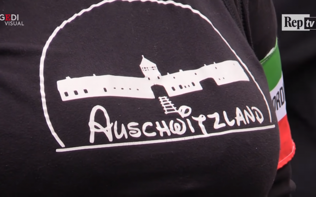 The woman's top with 'Auschwitzland' on it.