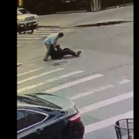 Screenshot from a video showing the incident in which the man is beaten up