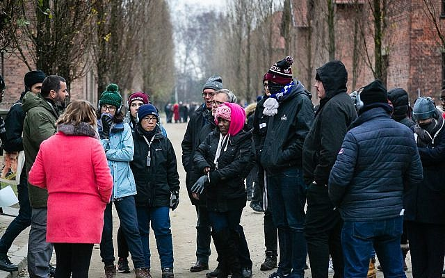 Students learn about the former Nazi death camp from a guide.  Photo credit: Yakir Zur