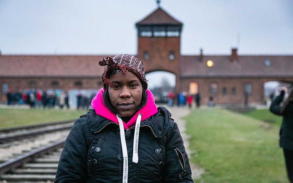 Shakira Martin, NUS president, with the infamous Auchwitz death gate in the background
