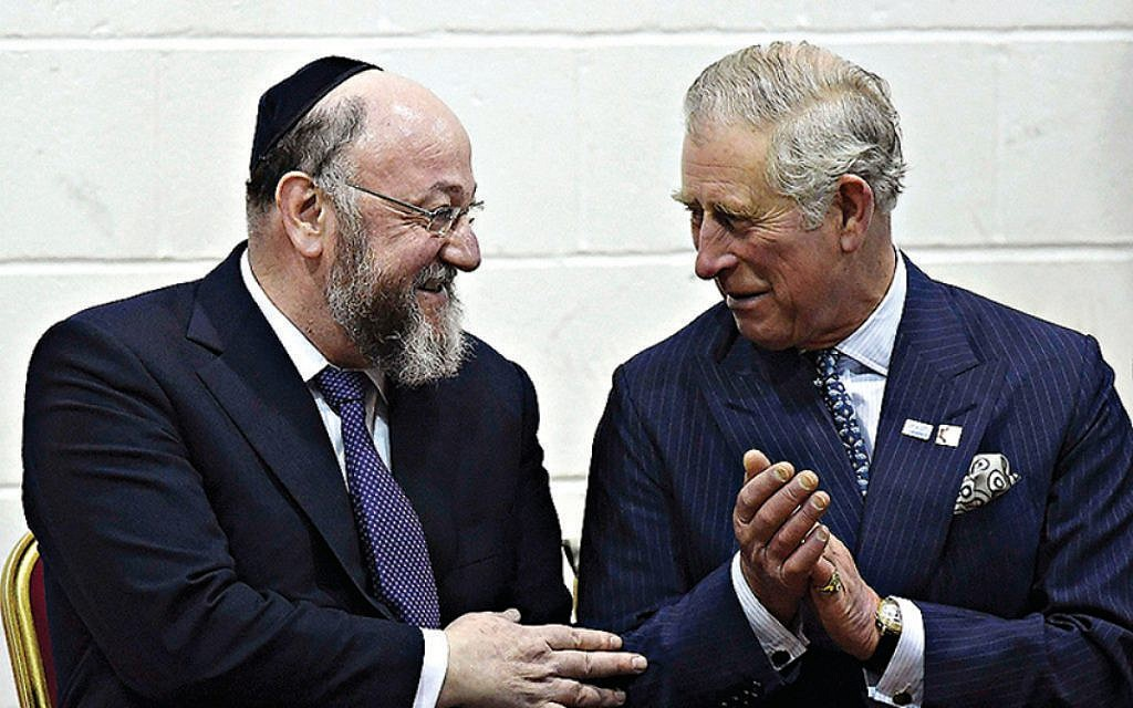 The Prince of Wales (right) speaks with chief rabbi Ephraim Mirvis during a visit to Yavneh College