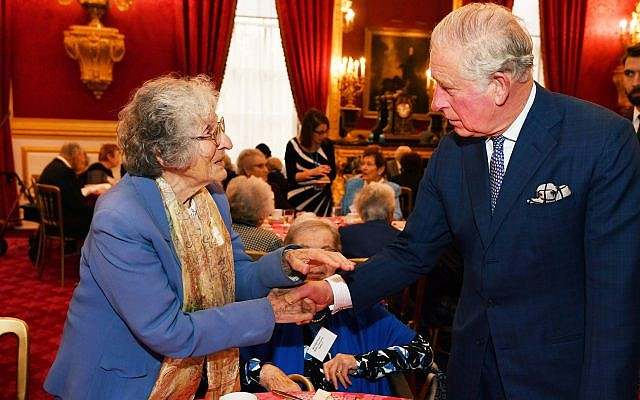 The Prince of Wales meets guest Dr Elizabeth Rosenthal, during a reception for the Association of Jewish Refugees in London, which marks the 80th anniversary of the Kindertransport. Photo credit: John Stillwell/PA Wire