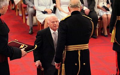 Sir Ben Helfgott receives his knighthood from the Prince of Wales at Buckingham Palace. Photo credit: Yui Mok/PA Wire