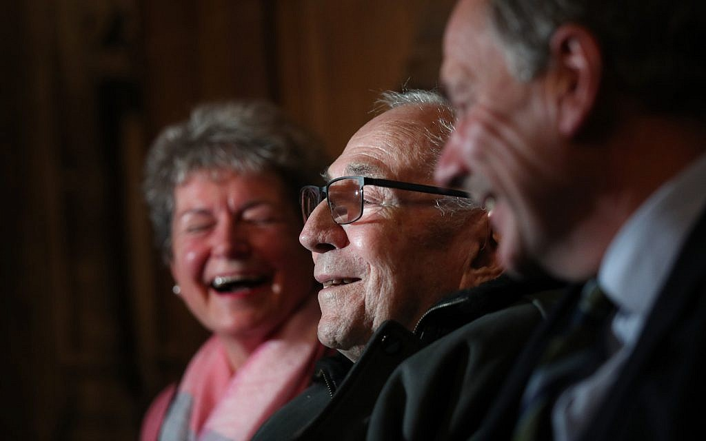 Paul Willer (centre), a Jewish refugee who escaped Germany in 1939, meets Jo Roundell Greene (left), the granddaughter of former prime minister Clement Attlee and Earl Attlee the grandson of Clement Attlee, in the Houses of Parliament. Photo credit: Yui Mok/PA Wire