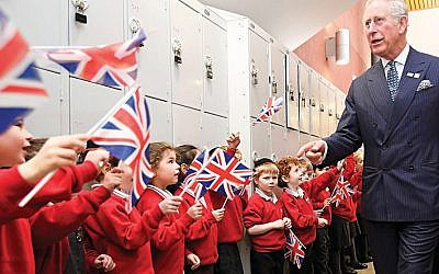 The Prince of Wales is greeted by pupils during his visit to Yavneh College in Borehamwood