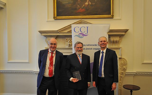 Lord Michael Howard, Rabbi Lord Sacks with his award, and David Lidington