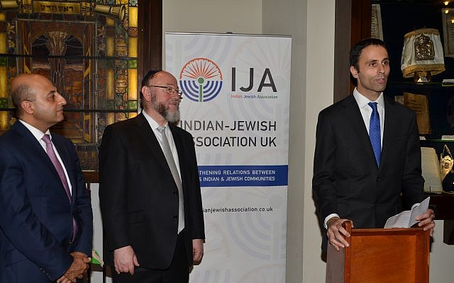 Lord Gadhia and Chief Rabbi Mirvis watching Zaki Cooper speak during the event at Marble Arch shul