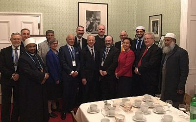 Members of the the National Council of Imams and Rabbis of the Joseph Interfaith Foundation present the specially commissioned card for HRH the Prince of Wales seventieth birthday