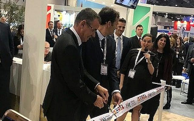Mark Regev cut the ribbon on the stand at the WTM, alongside the director general of the Israeli Tourism Ministry,