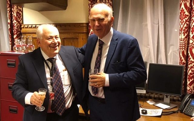 Lord Monroe Palmer, left, with party leader Sir Vince Cable