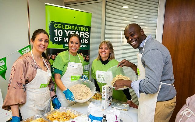 London Mayoral Candidate Shaun Bailey joins the chicken soup cook at JW3 - picture by Yakir Zur