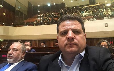 Aymen Odeh found himself next to Avigdor Lieberman