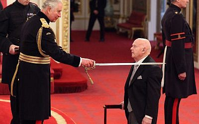 Sir Ben Helfgott is made a Knight Bachelor of the British Empire by the Prince of Wales during an Investiture ceremony at Buckingham palace, London.