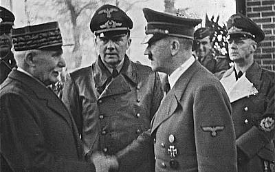 France's WWI hero Marshall Phillippe Pétain  meeting Hitler, with whom his Vichy-based wartime government collaborated.