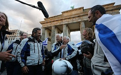 The riders arrive at Brandenburg Gate in Back To Berlin