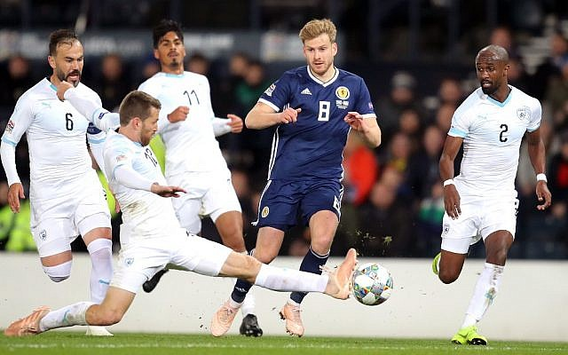 Scotland's Stuart Armstrong (second right) and Israel's Shiran Yeini (second left) battle for the ball when the two sides met in November 2018 (Jane Barlow/PA Wire.)