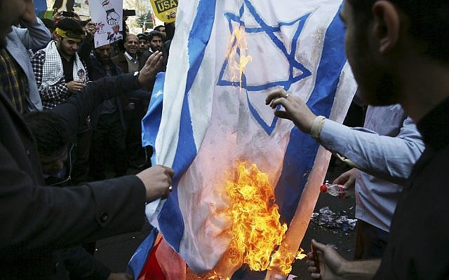 Demonstrators burn representations of Israeli and the U.S. flags during a rally in front of the former U.S. Embassy in Tehran (AP Photo/Vahid Salemi) (November 2018)