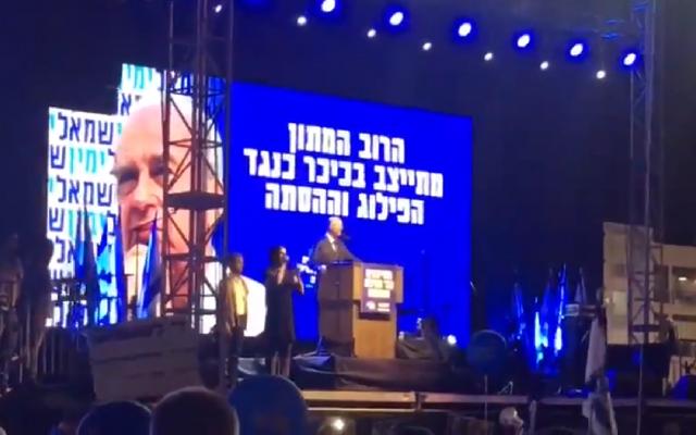 Tzachi Hanegbi speaking during the rally
