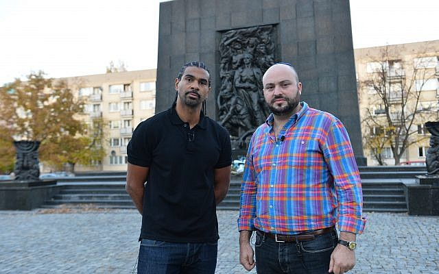 David Haye stands with British-Israeli Jonny Daniels, outside the monument to the Warsaw Ghetto Uprising.
