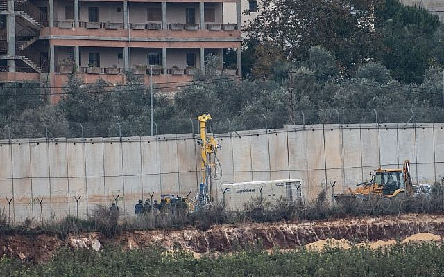 Picture taken from the Israeli Kibutz of Misgav Am, shows Israeli machinery operating near the border wall with Lebanon, destroying terror tunnels.  Photo by: JINIPIX