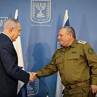 Israeli Prime Minister Benjamin Netanyahu shakes hands with Gadi Eizenkot  Photo by: JINIPIX
