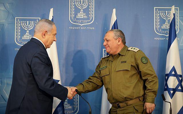 Israeli Prime Minister Benjamin Netanyahu shakes hands with Gadi Eizenkot  Photo by: JINIPIX