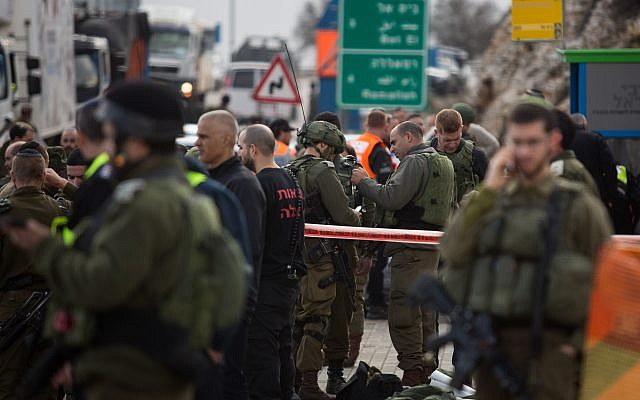 Israeli forces  inspect the site of a Palestinian drive-by shooting attack outside the West Bank settlement of Givat Asaf, northeast of Ramallah, on December 13, 2018.. Photo by: JINIPIX