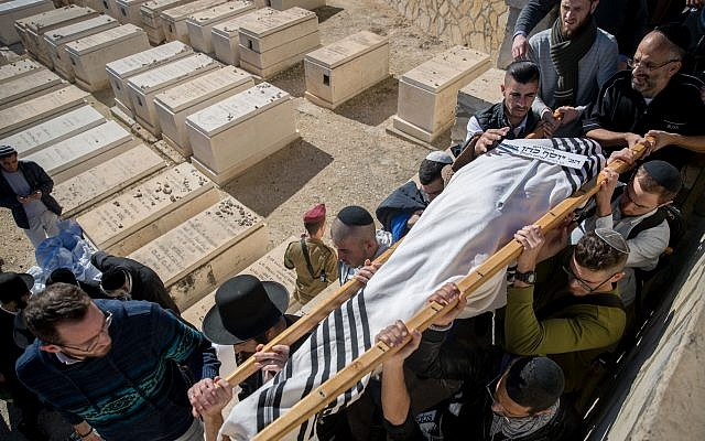 Relatives of the Israeli soldier Yosef Cohen carry his body during his funeral in Jerusalem, Israel, 14 December 2018. Cohen was killed with another Israeli soldier during a drive-by shooting attack next to the Israeli West Bank settlement of Givat Asaf, near Ramallah on 13 December 2018. Photo by: JINIPIX