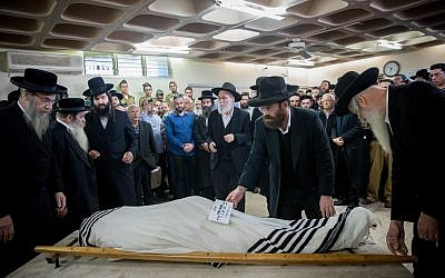 Comrades and relatives of killed Israeli soldier Yosef Cohen mourn during his funeral in Jerusalem on December 14, 2018. Two Israeli soldiers were killed yesterday as a Palestinian assailant shot fire on a group of Israelis in the occupied West Bank near Ramallah.  Photo by: JINIPIX