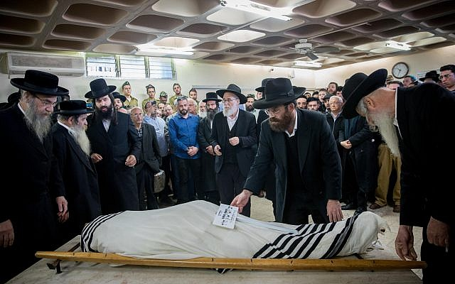 Comrades and relatives of killed Israeli soldier Yosef Cohen mourn during his funeral in Jerusalem on December 14, 2018..  Photo by: JINIPIX