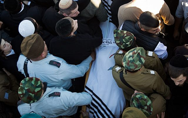 Soldiers and Comrades of the Israeli soldier Yosef Cohen carry his body during his funeral in Jerusalem, Israel, 14 December 2018. Cohen was killed with another Israeli soldier during a drive-by shooting attack next to the Israeli West Bank settlement of Givat Asaf, near Ramallah on 13 December 2018. Photo by: JINIPIX