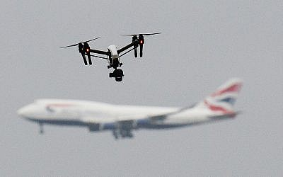 A drone and an aircraft, amid the chaos at Gatwick airport after drones were spotted over the airfield. Photo credit: John Stillwell/PA Wire