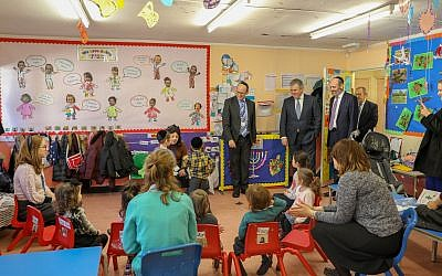 Brandon Lewis in a Side-by-Side school classroom
