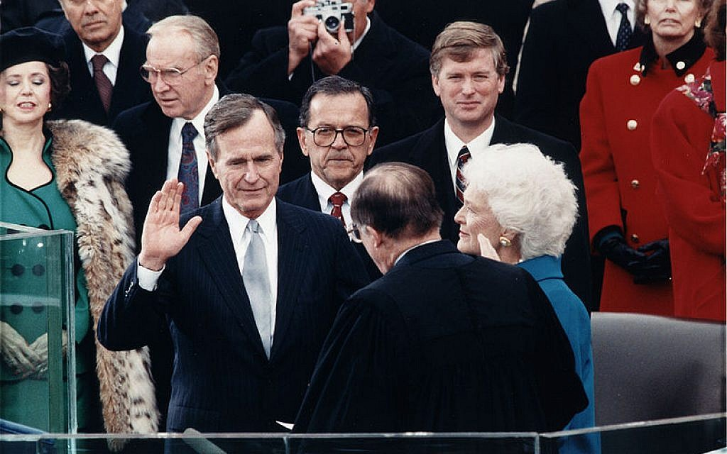 President George H. W. Bush during Inaugural ceremonies at the United States Capitol. January 20, 1989. Source: Wikimedia Commons. Credit: Library of Congress.)