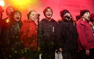 Youngsters in fine voice on stage during Chanukah in the Square. Pic: Marc Morris.
