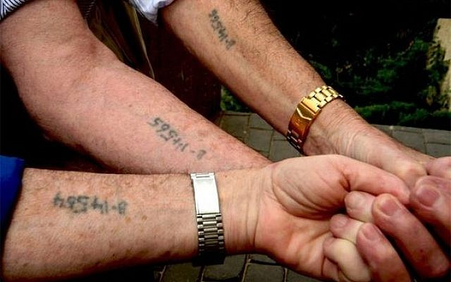 Mexican asylum seekers hold out their arms to reveal numbers written in permanent marker. Posted by Adam Best (@adamcbest) on Twitter