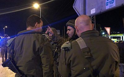 Soldiers at the scene of the shooting in the West Bank