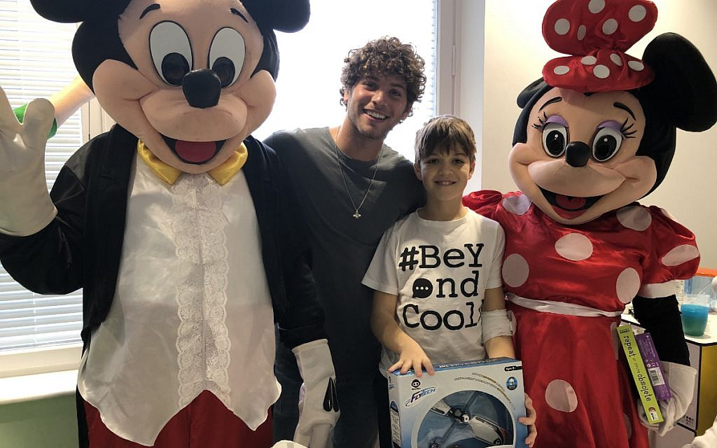 Love Island's Eyal Booker with Camp Simcha at the Royal Free for the charity's Toy Drive! Here he meets Zac Robinson, 11