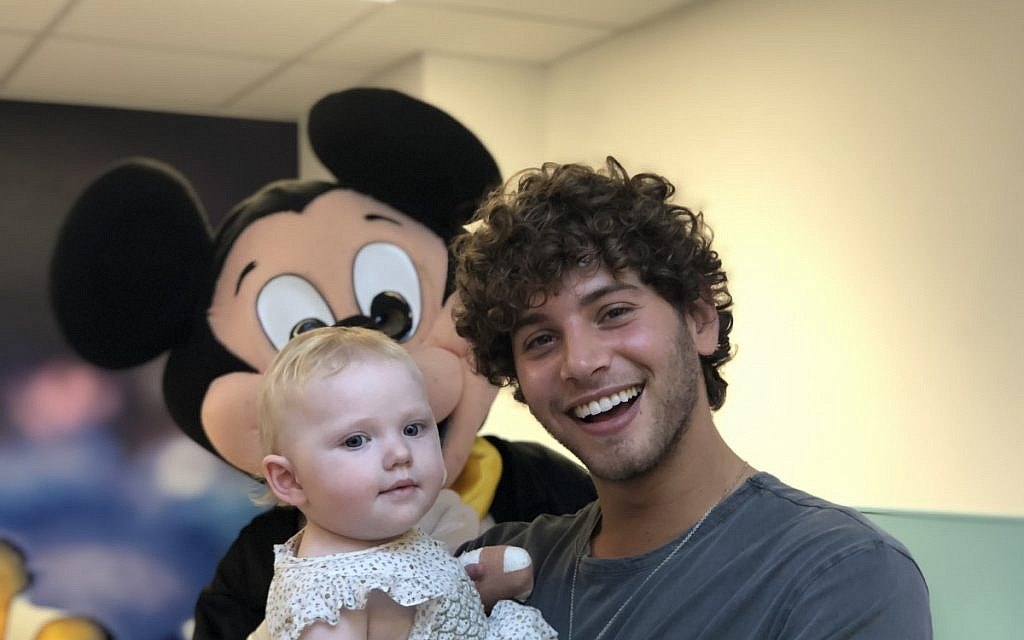 Love Island's Eyal Booker with Camp Simcha at the Royal Free for the charity's Toy Drive!