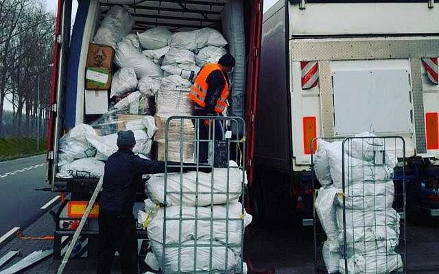 Packing lorries with gifts for refugees