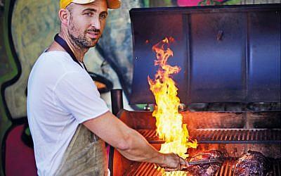 Josh Katz over the BBQ