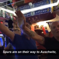 Screenshot from the video released by Kick It Out, which shows two fans performing Nazi salutes