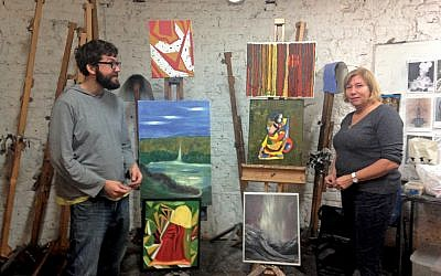 Tania Kaczynski and Jon Martyn with some of the artwork created by members