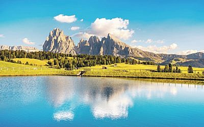 Lake and mountains at sunset, Dolomites Alps