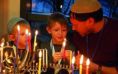 Young children light the Chanukiah during a previous Limmud