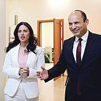 Israeli Education Minister Naftali Bennett (R) and Justice Minister Ayelet Shaked, from the Jewish Home party