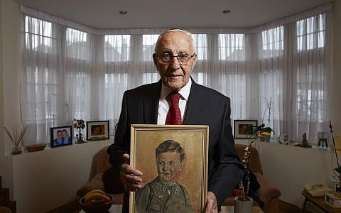 The Last Survivors -  Manfred Goldberg holding a painting of his brother. ((C) Minnow Films Ltd - Photographer: Richard Ansett)