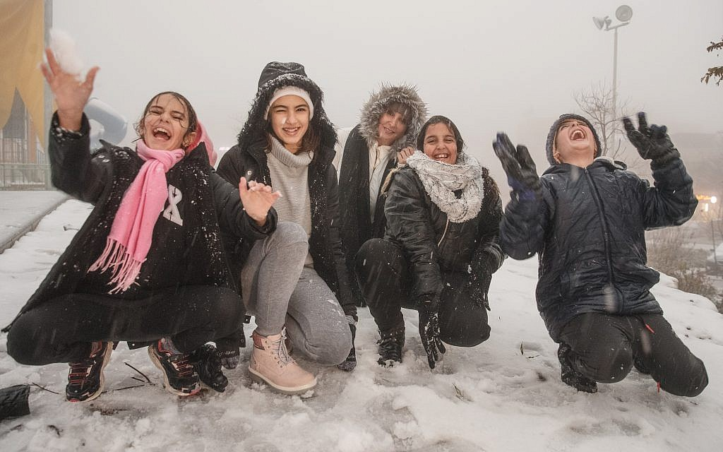 Israeli children experience the snowy conditions. Credit: Ancho Gosh