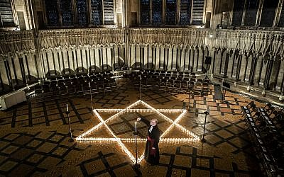 Canon Chancellor Christopher Collingwood helped light six hundred candles at York Minster in memory of more than 6 million Jewish people murdered by the Nazis on HMD last year  Photo credit: Danny Lawson/PA Wire